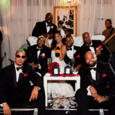 bride and groomsmen pose