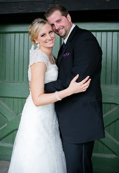 Bride and groom portrait at the McKinney Flour Mill by Dallas wedding photographer.