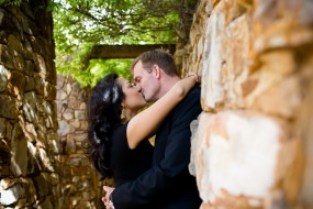 Dallas engagement photos wedding photography engaged couple kissing against rock wall at Gaylord hotel