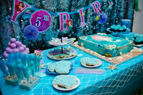 dessert cake with little mermaid birthday party cake, cupcakes, cookies, candy