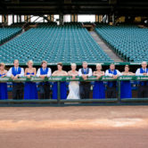 wedding party group photo at the texas rangers baseball dugout in the ballpark