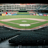open and wide view of the texas rangers ballpark field and completely empty stands