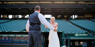 Bride and groom first look on the baseball field of the Texas Rangers Ballpark wedding by dallas wedding photographer monica salazar photography.