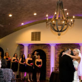 Bride and groom first dance under a chandelier at the Chapel at Ana Villa in the Colony TX by Dallas wedding photographer