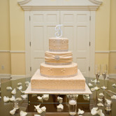 Beautiful wedding cake by frosted art at arlington hall in dallas texas.