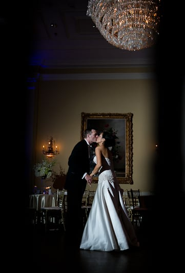 Wedding last dance of bride and groom at their wedding reception in Dallas TX at the Arlington Hall Lee Park wedding venue by Dallas wedding Photographer Monica Salazar.