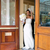 The bride exiting the hotel as she gets ready to get in the limo to head to the chapel