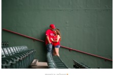 baseball themed engagement pictures in the stands at the texas rangers ballpark globe life park in arlington texas by dallas fort worth wedding photographers