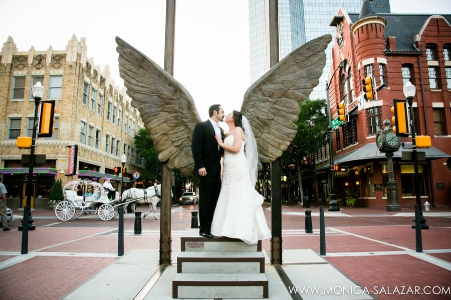 Wedding Photography Ft Worth: Bride And Groom Portrait With Wings In The City Sculpture