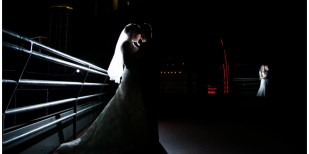 city club wedding in fort worth texas with portrait of bride and groom on terrace with downtown fort worth skyline view