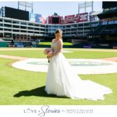bridal portraits on baseball field at texas rangers ballpark by dallas wedding photographer