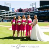 bride and bridesmaids on the baseball field
