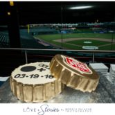 wedding cake photos with baseball field in background