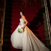 Bridal portraits on red and elegant staircase at the Worthington Hotel in downtown Fort Worth TX.