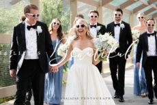 Bride, groom and bridal party group photo. Fun photo of them at a destination wedding.