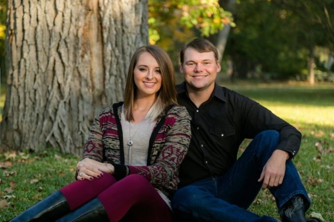 engagement photos at the fort worth botanical gardens by fort worth wedding photographer monica salazar. engagement photos of the couple sitting down in front of a tree at sunset and an outdoor photo session.